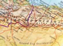 Geographic map of traveler focused on Atlas Mountains stock photography
