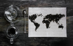 Geographic map of the world, lined with tea leaves on old paper. Eurasia, America, Australia, Africa. vintage. green tea Stock Photo