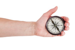 Geographical compass in human hand Royalty Free Stock Photo