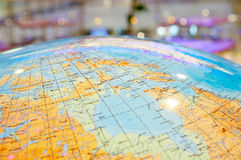 The geographical globe. Top of the geographical globe on a dim background royalty free stock images