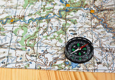 Geographical map and a compass. Stock Images
