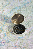 Geographical map and a compass. Stock Photography
