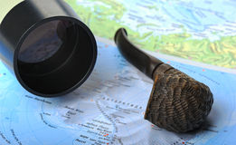 Geographical maps a telescope and smoking pipe Stock Photo