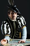 Geography. Portrait of a handsome man grandee in 16th century costume. Shot in a studio Royalty Free Stock Images