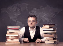 Geography teacher at desk Royalty Free Stock Image