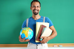 Geography teacher. Photo adult man with books and globe Stock Photos