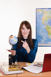 Geography teacher points a finger at the globe Stock Photo