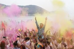 Geoje, SOUTH KOREA - MARCH 2018: Holi festival. The Color powders throwing countdown Royalty Free Stock Photo