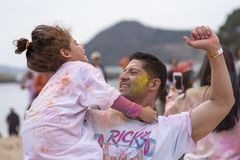 Geoje, SOUTH KOREA - MARCH 2018: Holi festival. Father and his child are dancing at Holi festival Stock Photography