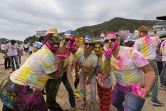 Geoje, SOUTH KOREA - MARCH 2018: Holi festival. The young guys with colored faces Stock Photos