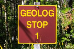 A Geolog Stop sign at a park royalty free stock photos