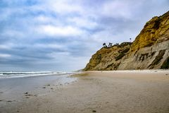 Geologic Cliff Striations at Black`s Beach in San Diego. This shot emphasizes the geologic striations of the cliffs at Black`s Beach in San Diego Stock Images