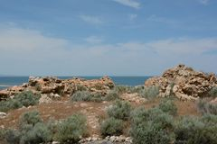 Geologic Perspective On Antelope Island State Park. Bright spring perspective of ancient quartzite rock formations on Antelope Island State Park, northern Utah royalty free stock images