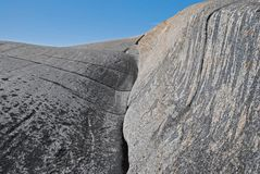Geologic rock formation. Details of geologic rock formation caused by ocean waves, blue sky Stock Photos