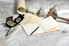 Geological expedition. The geological expedition is prepared with the study of topographic maps. On the table the tools of the geologist Royalty Free Stock Photos