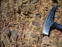 Geological hammer. For scale on top of sediments stock photography