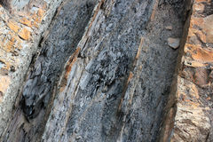 Geological layers of earth - layered rock background. Close-up royalty free stock photos
