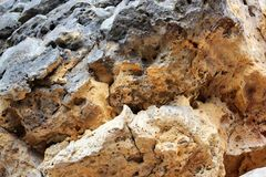 Geological layers of earth - Layered rock background. rock layer sediment. Layer of yellow sand. Crust of the Earth. Strata, slate. Or shale rock layers royalty free stock photography