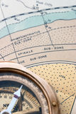 Geological map and compass. An old surveying compass on a detailed geological map showing faunal zones Royalty Free Stock Photo