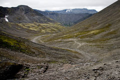 Geological road in Khibini. A road made by geologists in the arctic desert behind the Polar Circle. Khibini mountains, Russia Royalty Free Stock Photos