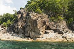 Geological Rock Formation. With tree and sea stock photo