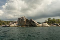 Geological Rock Formation. With tree and sea at Koh Lipe Thailand stock photos