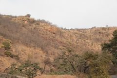 Geological Rock Layers in Mountain. The Gwalior System of The ancient lava rocks are comparatively exposed over a large area north-west of the eastern fault and Stock Photos