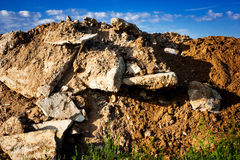 Geological soil cut on blue sky background Stock Image