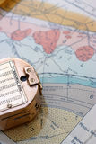 Geological survey. A surveyor's compass sits on top of a geological map royalty free stock image
