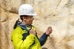 Geologist examines a sample of stone outdoor royalty free stock image