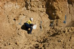 Geologist Sampling Rocks - Australia. Geologist Sampling Inside Pit - Australia royalty free stock image