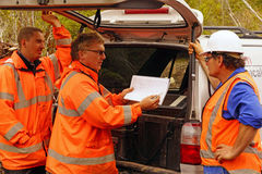 Discussing the survey. Geologists in the field discuss the results of a seismic reflection survey Royalty Free Stock Images