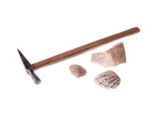 Geology. Small hammer and some fossils isolated Stock Photography