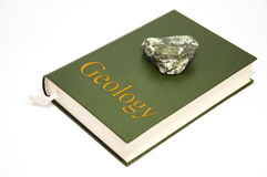 Geology book. With a marble-look green tone on it royalty free stock image