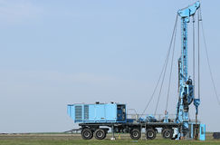 Geology and oil exploration mobile drilling rig vehicle. On field Royalty Free Stock Image