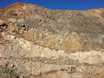Geology rocks in open pit mine mining wall Royalty Free Stock Photos