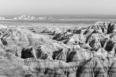 Geology Rock Formations Badlands National Park South Dakota. Clouds allow the sun to light rock formations in the South Dakota Badlands royalty free stock photography