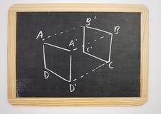 geometria sześcianu pomiaru diagram na blackboard Fotografia Stock