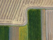 Panoramic view from flying drones to agricultural fields, prepared for sowing crops. Top view. royalty free stock images