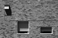 Geometric abstract composition. A fragment of a brick wall with pronounced texture and strong horizontal and vertical lines, rectangular shapes, light and Stock Images