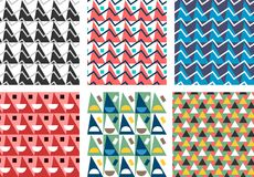 Geometric abstract seamless pattern set. Simple triangles motif. Background. Colorful decoration design collection. Trendy style illustration Royalty Free Stock Photography
