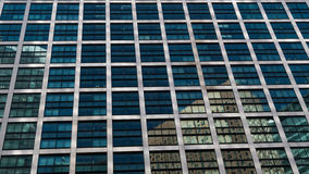 Geometric architectural abstraction. Beautiful geometric abstraction of the architectural facade and reflection of architectural objects in the panoramic glazing royalty free stock photos