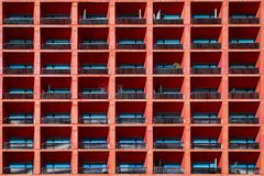 Geometric architectural background of coral color. Part of a building in Mexico City. stock photography