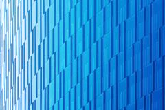 Geometric architectural urban background in blue tones. The glass facade of a skyscraper. Geometric architectural urban background in blue tones. The glass royalty free stock image