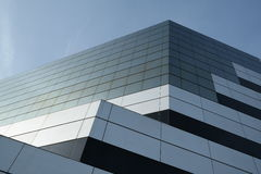 Geometric architecture. Glass modern building with tiles Stock Photos