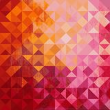 Geometric background of colored triangle. In warm colors with grunge texture Royalty Free Stock Image