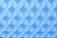 Geometric background with diamond structure in blue tone. Stock Photos