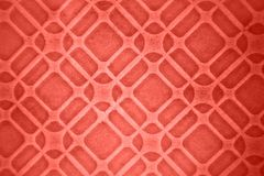 Creative geometric pattern from ceramic tiles in a fashionable pantone trendy color of the year 2019 Living Coral. royalty free stock photo