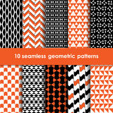 10 geometric black orange and white seamless patterns set. 10 geometric seamless patterns set, black, orange and white vector backgrounds collection Stock Image