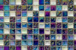 Geometric blue, purple and green mosaic tiles pattern. Wallpaper. Texture background. Small pieces tiles for construction and renovation works, decorative stock image
